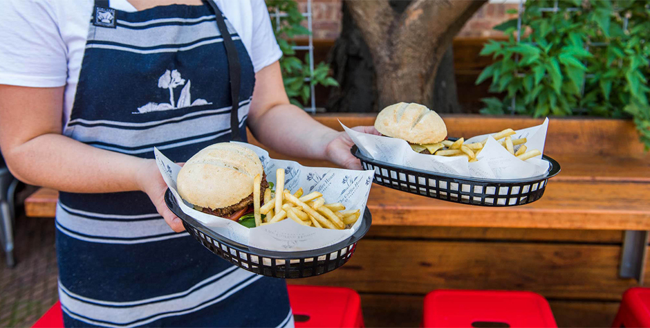 The Coffee House Mudgee Waitress Carrying Burgers